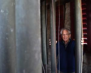 St Matthew's Church bell ringer Dr Jim Faed checks the set of tubular bells in the church...