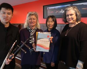 Jeffrey Zhao (from left) stands with bookseller Caroline Harker and the book's editors, Alison...