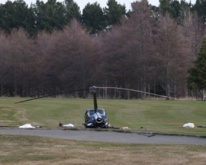 Debris across the golf course after this afternoon's serious helicopter crash. Photo: George...