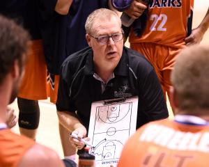 Coach Rob Beveridge talks to his Southland Sharks players during a game earlier this season....