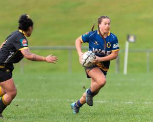 Teilah Ferguson, of Otago Spirit, makes a break during her team's round one Farah Palmer Cup...
