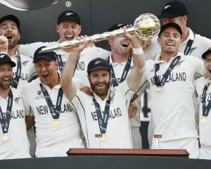 Captain Kane Williamson holds the Mace as the Black Caps celebrate becoming World Test Champions....