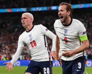 England's Harry Kane (R) celebrates scoring their second goal with teammate Phil Foden. Photo:...