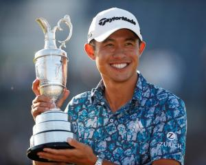Collin Morikawa celebrates with the Claret Jug after winning The Open Championship. Photo: Reuters