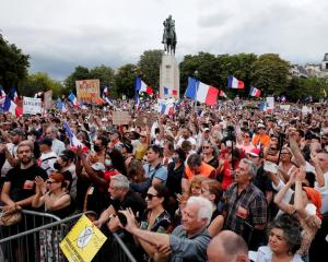 Protesters take part in a rally against Covid-19 restrictions at the Trocadero Square in Paris....