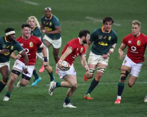 Centre Robbie Henshaw runs the ball up for the Lions against South Africa. Photo: Reuters