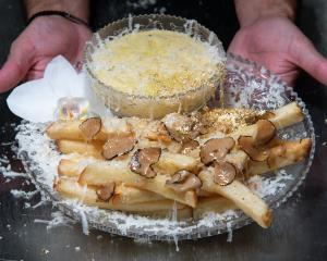 Chef Frederick Schoen-Kiewert serves The Creme de la Creme Pommes Frites at Serendipity 3...