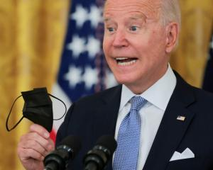 US President Joe Biden speaks about the pace of coronavirus vaccinations during a media briefing...