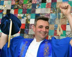 Adrian Woodhouse tries on newly designed regalia which he will wear when he becomes Otago...