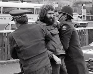 Protester Alastair Duncan is led away by police in Dunedin during a 1981 protest. PHOTO: ODT FILES
