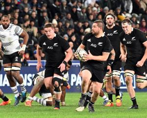 All Blacks four-try hero Dane Coles breaks down field supported by team-mates (from left) Ethan...