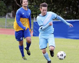 Otago University's En Watanabe tracks South City Royals defender Kaleb de Groot-Green during a...