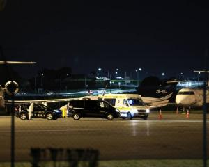 A plane believed to be carrying a Covid-19 positive person from Fiji arrived at Auckland Airport...