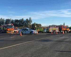 Emergency services at the scene of the crash in Mosgiel this afternoon. Photo: Christine O'Connor