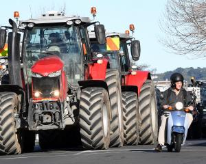 A convoy of tractors heads along Princes St in Dunedin yesterday as part of Groundswell NZ's Howl...