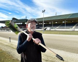 Track manager Ken McFarlane prepares for the last night of racing at Forbury Park. PHOTO: PETER...