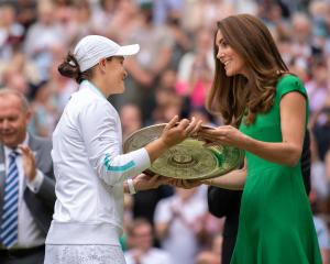Catherine, Duchess of Cambridge, presents Ash Barty with the Venus Rosewater Dish trophy after...