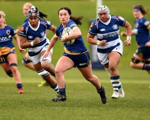 Otago winger Oceana Campbell makes a break during the Farah Palmer Cup game between Otago and...