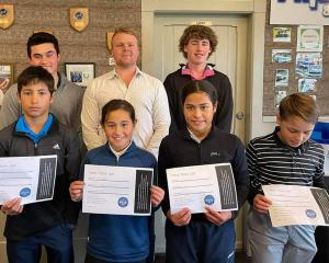 Sponsor Ben Patston (back row centre) with leading performers in the Otago junior golf series ...