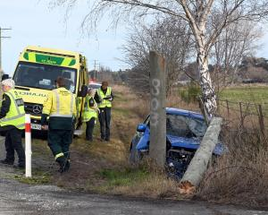 Emergency services attend the crash in Goodwood yesterday. PHOTO: LINDA ROBERTSON