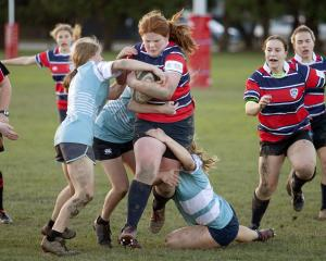 Keiana Roffey makes ground for CGHS with Jesse Stevens in support. Photo: Geoff Sloan