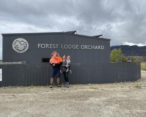 Mike and Rebecca Casey with their children Connie and Bowie at home at Forest Lodge Orchard....