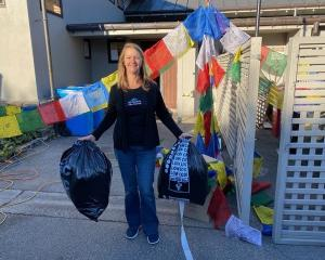 New Zealand Mountain Film Festival co-director Jo Sedon with a bag of rubbish sourced from the...