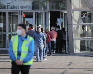 People line up for their jabs at the Manukau venue in Auckland. Photo / Michael Craig