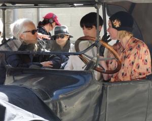 Actress Kirsten Dunst sits alongside actor Kodi Smit-McPhee while chatting to Campion during...