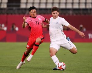Liberato Cacace of Team New Zealand is challenged by Dongjun Lee of Team South Korea during the...