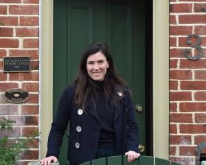 Moving into the Robert Lord cottage in Titan St, North Dunedin, yesterday is Port Chalmers writer...
