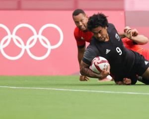 Regan Ware is tackled short of the try line during the Rugby Sevens Men's Semi-final match...