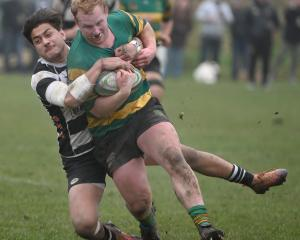 Green Island prop Shane Fikken is tackled by Southern winger Tama Apineru during the Dunedin...