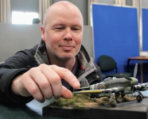 John Fenton proudly displays his model Hawker Typhoon, which won best of the show at South Island...