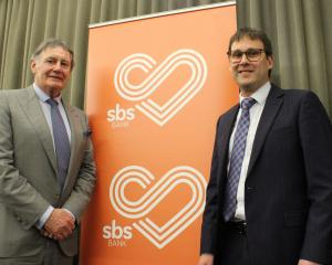 Former SBS board chairman John Ward (left) and incoming chairman Joe O'Connell attend the bank's...