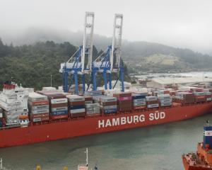 Port Otago's tugs nudge Rio Bravo into the container berth behind Rio Blanco at the multi-purpose...