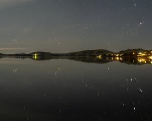 Otago Harbour's waters became a perfect mirror recently, reflecting starlight, and streetlights....