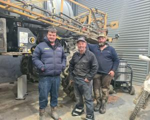Inspecting a crop sprayer in South Otago are (from left) Seed Grower of the Year Craig Whiteside...
