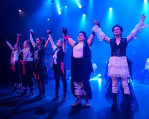 Rock opera . . . The cast of Taieri Musical Society's production of That Bloody Woman are ready...