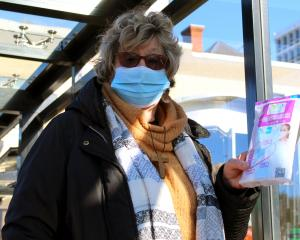 Mask up . .. Anne Marie Parsons, of Kaikorai Valley, shows face masks she gives out for free to...