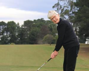 St Clair Golf Club member Jenni Harford, of Dunedin, prepares to tee off on a windy day, earlier...