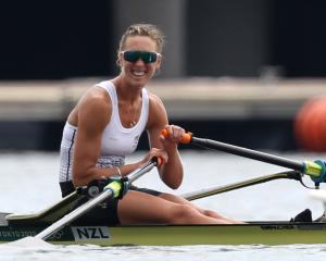 New Zealand's Emma Twigg was rewarded for her perseverance with a gold medal after getting fourth...