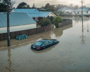 Floodwaters in Westport have damaged hundreds of cars beyond repair. PHOTO: NZDF