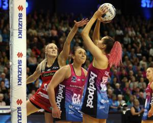Southern Steel shooter George Fisher (right) attempts a shot while marked by Tactix goal keep...