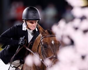 Jonelle Price riding Grovine De Reve finished highest of the Kiwi trio in 11th place. Photo: Reuters