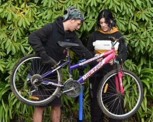 Alex Gorrie and Lilly Hamilton (16) work on a bike at the Malcam Trust this week. PHOTO: GREGOR...