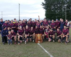 Clutha Valley celebrates after its win over Cromwell in the countrywide final at Clydevale on...