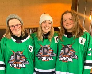 Dunedin Thunder captain Abbey Heale (centre) is flanked by assistants Anna Goulding (left) and...