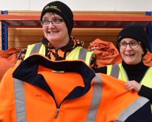 Cargill Enterprise's Sharon Thorley (left) and Michella van Nugteren hold a reconditioned jacket...