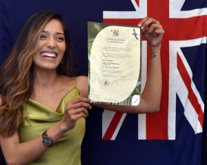 Sahitya Anand proudly displays her citizenship certificate after becoming a New Zealand citizen...